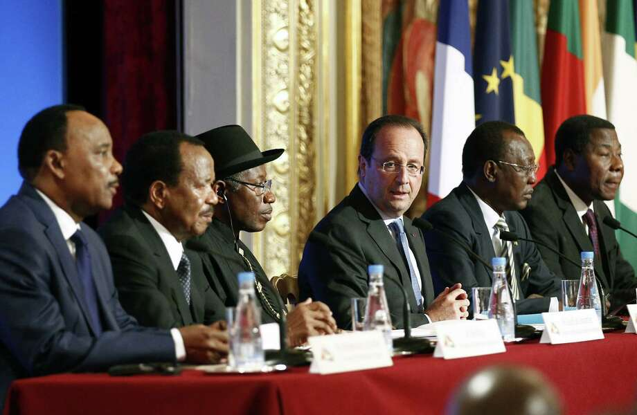 At a news conference at a Paris summit to devise  ways to fight terrorists in West Africa, leaders Maha-madou Issoufou of Niger, from left, Paul Biya of Cameroon, Goodluck Jonathan of Nigeria, Francois Hollande of France, Idriss Deby Itno of Chad and Thomas Boni Yayi of Benin talk to reporters. Photo: Thierry Chesnot, Stringer / 2014 Getty Images