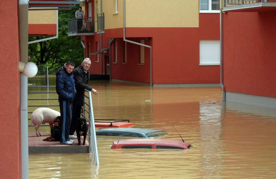 People wait for evacuation at their flooded house in Obrenovac, west of Belgrade, Serbia, on Saturday. Photo: ALEXA STANKOVIC, Stringer / AFP