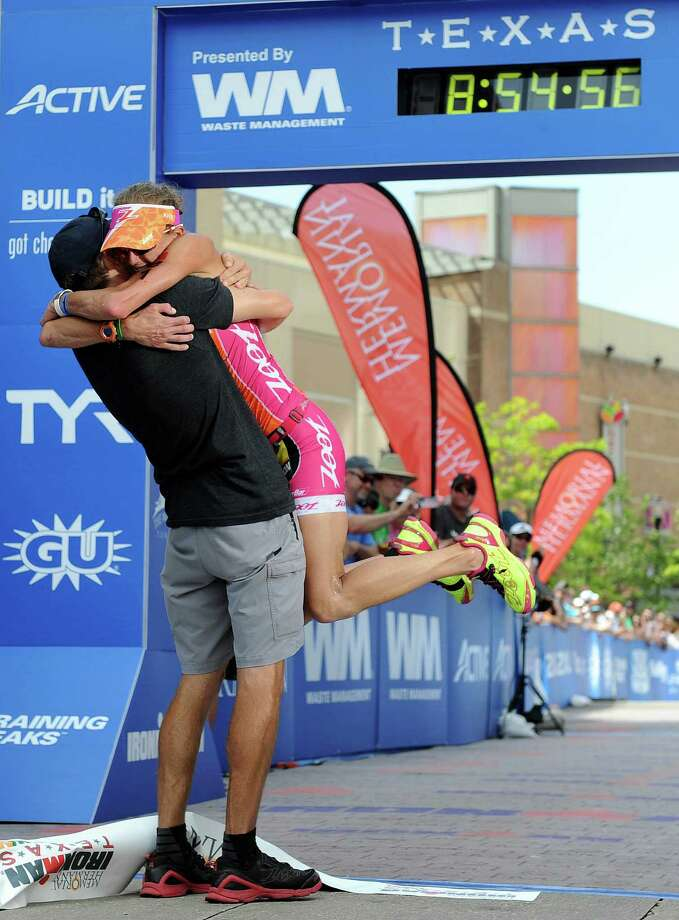 Winner Bevan Docherty holds the finish-line tape after the Memorial Hermann Ironman Texas. Photo: Eric Christian Smith, Freelance