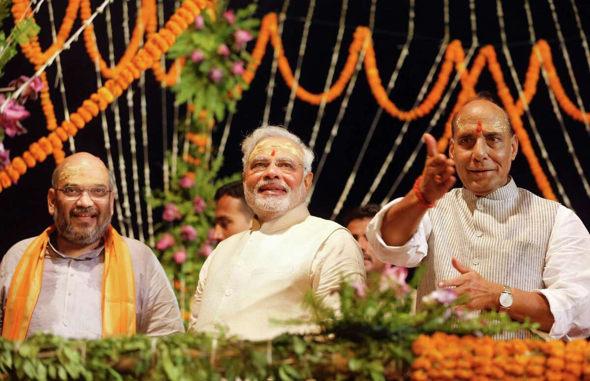 Hindu nationalist Bharatiya Janata Party leader and India's next prime minister, Narendra Modi, center, celebrates Saturday on the banks of the River Ganges with BJP President Rajnath Singh, right, and Amit Shah, BJP general secretary.
