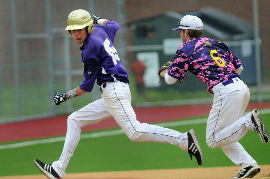 CBA's Brady Fallon, left, runs to third but gets out on a rundown from Troy's Vinny LeClair during their baseball game on Saturday, May 17, 2014, at Troy High in Troy, N.Y. (Cindy Schultz / Times Union) Photo: Cindy Schultz / 00026939A