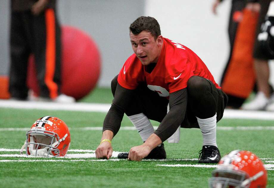 First-round draft pick Johnny Manziel took part in his first workout as a member of the Browns on Saturday during the team's rookie minicamp. Photo: David Maxwell, Stringer / 2014 Getty Images
