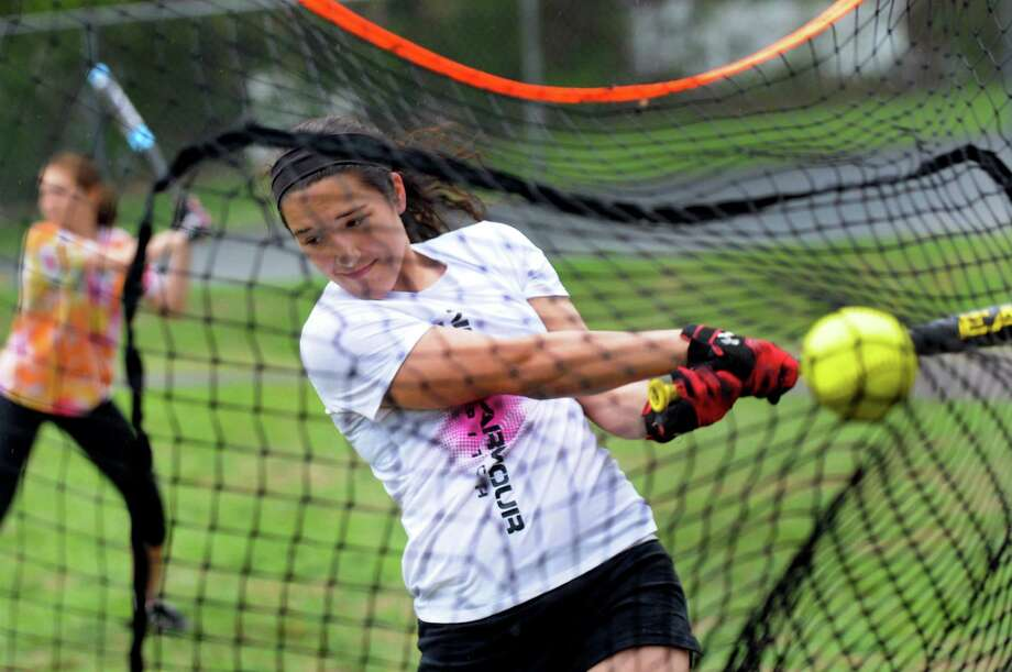 Alyssa Salisbury bats into a net during softball practice on Friday, May 16, 2014, at Notre Dame Bishop Gibbons in Schenectady, N.Y. (Cindy Schultz / Times Union) Photo: Cindy Schultz / 00026936A