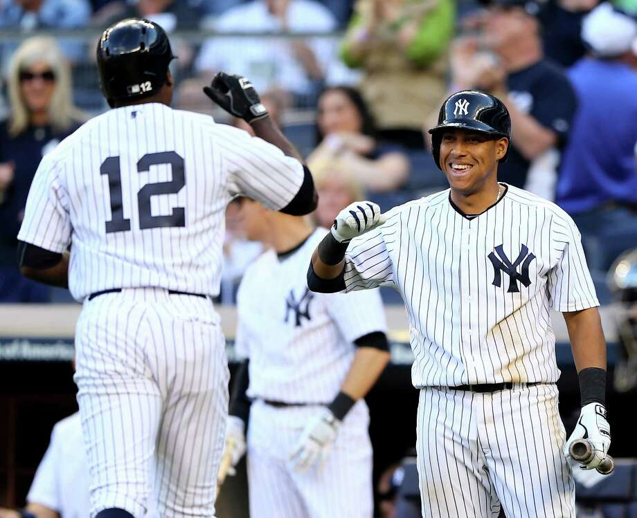 NEW YORK, NY - MAY 17:  Alfonso Soriano #12 of the New York Yankees is congratulated by teammate Yangervis Solarte #26 after Soriano hit a solo home run in the seventh inning against the Pittsburgh Pirates on May 17, 2014 at Yankee Stadium in the Bronx borough of New York City.  (Photo by Elsa/Getty Images) ORG XMIT: 477583335 Photo: Elsa / 2014 Getty Images