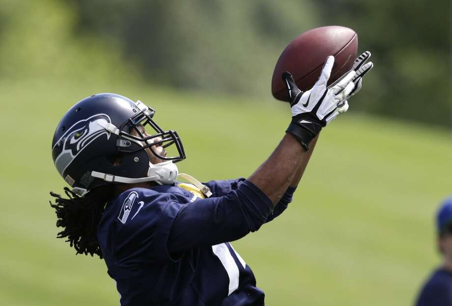Seattle Seahawks' Arceto Clark catches the ball during NFL football rookie minicamp Saturday, May 17, 2014, in Renton, Wash. (AP Photo/Elaine Thompson) Photo: AP