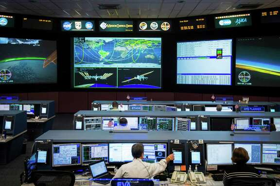 Flight controllers monitor the International Space Station at the Mission Control Center at NASA's Johnson Space Center in Clear Lake on Thursday.