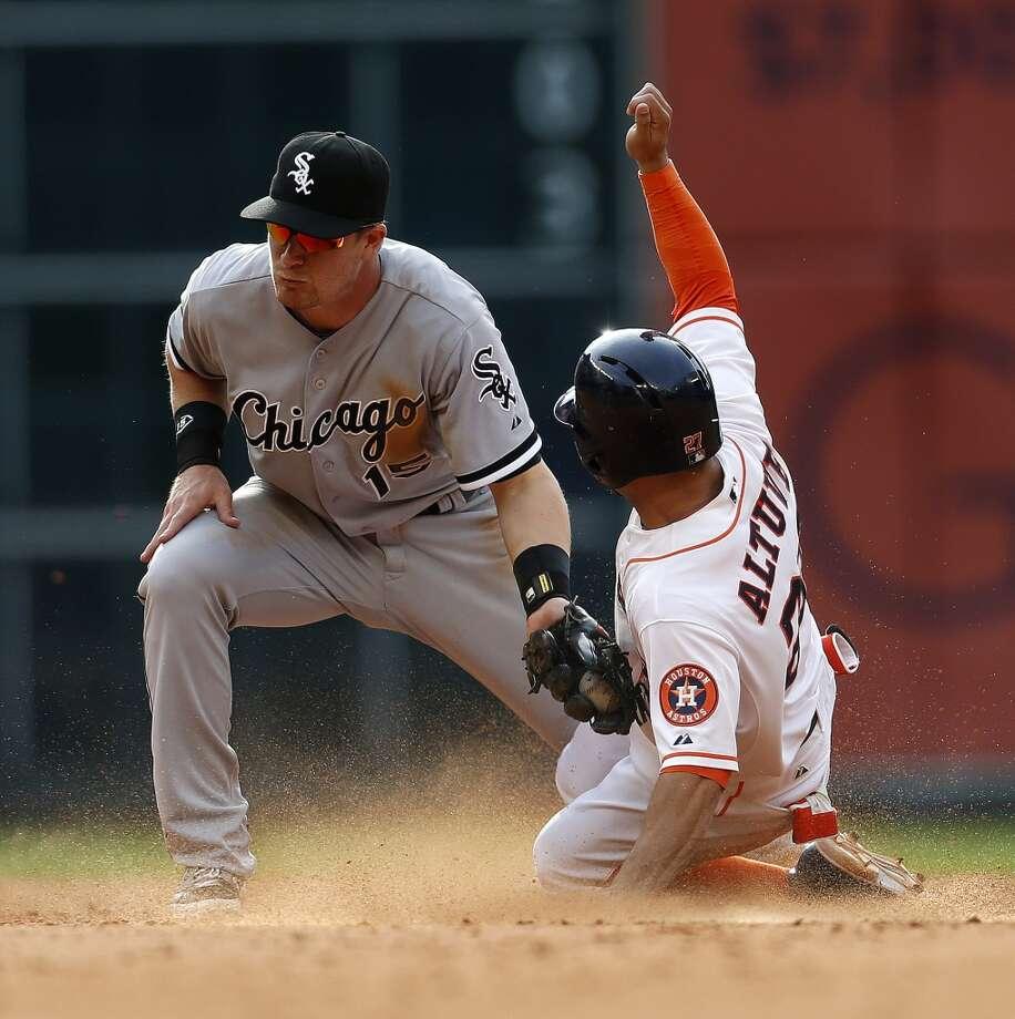 Astros second baseman Jose Altuve steals second. Photo: Karen Warren, Houston Chronicle
