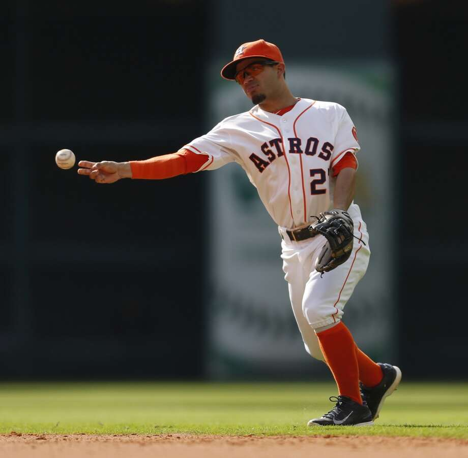 Astros second baseman Jose Altuve makes a throw to first on a ground out by White Sox second baseman Gordon Beckham. Photo: Karen Warren, Houston Chronicle