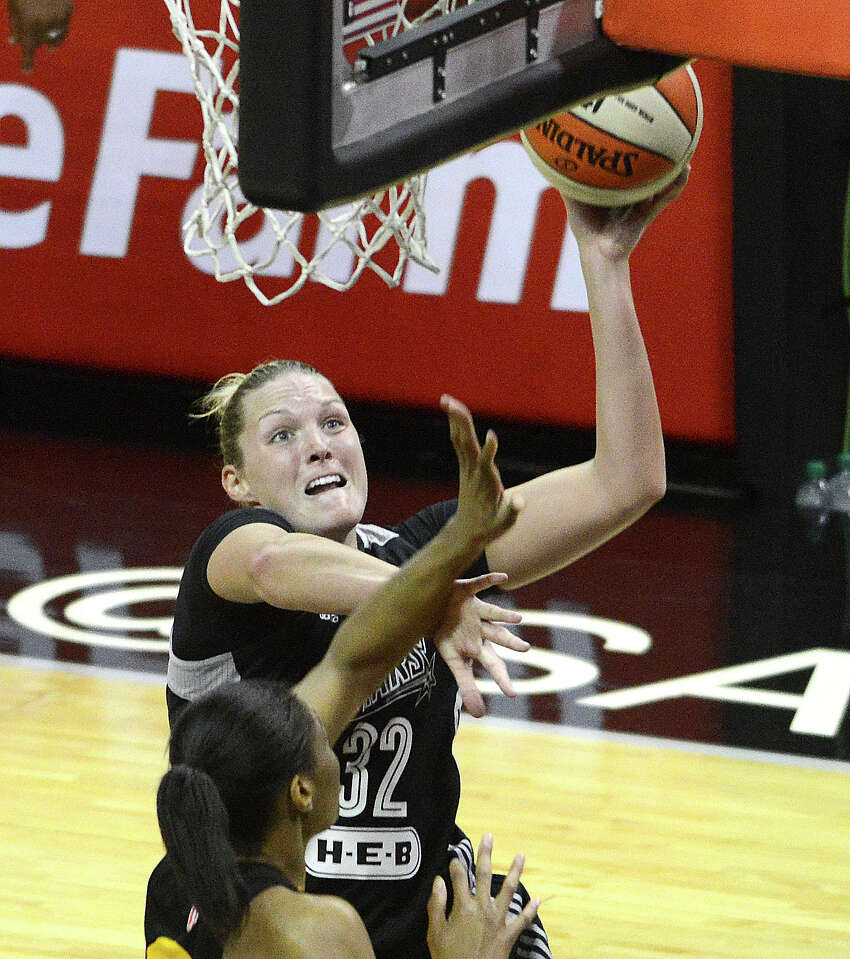 Jayne Appel of the San Antonio Stars shoots over Vicki Baugh of the Tulsa Shock during WNBA action in the AT&T Center on Saturday, May 17, 2014.
