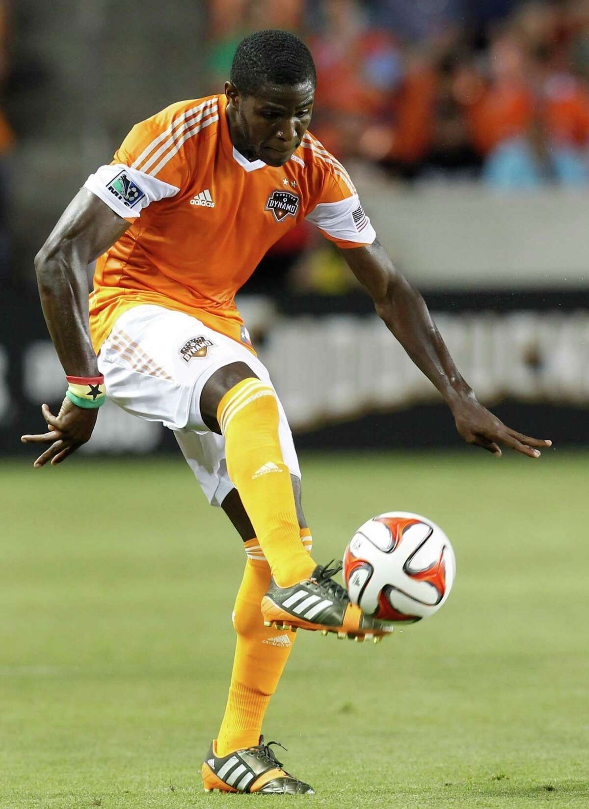 Houston Dynamo defender Kofi Sarkodie (8) traps the ball again as the Los Angeles Galaxy in the first half on May 17, 2014 at BBVA Compass Stadium in Houston, Texas.