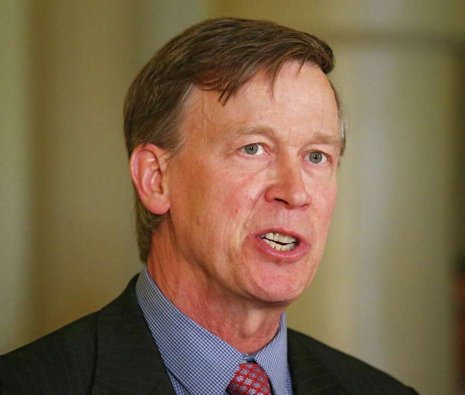 """FILE - Colorado Gov. John Hickenlooper speaks at a news conference at the Capitol in Denver in this Wednesday, May 22, 2013 file photo. Hickenlooper Saturday afternoon May 17, 2014 will sign Colorado's """"Right To Try"""" bill, which was passed unanimously in the state Legislature. The """"Right To Try"""" law allows terminally ill patients to obtain experimental drugs without getting federal approval. The bill doesn't require drug companies to provide any drug outside federal parameters, and there's no indication pharmaceutical companies will do so. (AP Photo/Ed Andrieski, File) Photo: Ed Andrieski, STF / AP"""