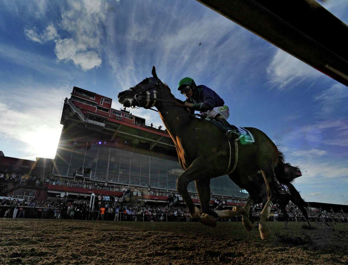 California Chrome, with jockey Victor Espinoza in the irons wins the second leg of thoroughbred racing's Triple Crown with his win in the 139th running of The Preakness Stakes Saturday evening May 17, 2014 at Pimlico Race Course in Baltimore, Maryland. (Skip Dickstein / Times Union)
