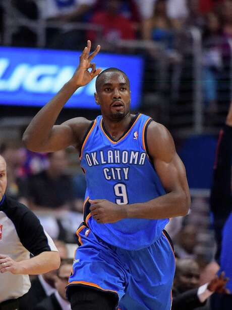 Oklahoma City Thunder forward Serge Ibaka, of Congo, gestures hatter hitting a three point shot in the first half of Game 4 of the Western Conference semifinal NBA basketball playoff series against the Los Angeles Clippers, Sunday, May 11, 2014, in Los Angeles. (AP Photo/Mark J. Terrill) Photo: Mark J. Terrill, STF / AP
