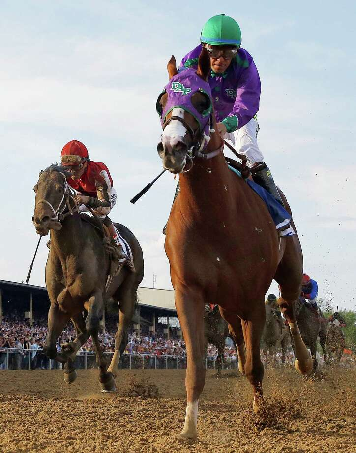 California Chrome, ridden by Victor Espinoza, outpaces Ride On Curlin by 11/2 lengths at Pimlico. Photo: Matt Slocum, STF / AP