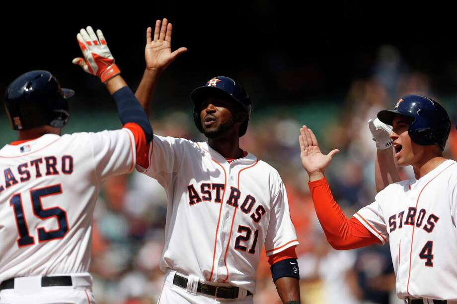 Hitting second and third in the order, outfielders George Springer (4) and Dexter Fowler (21) scored four of the Astros' six runs against the White Sox. Photo: Karen Warren, Staff / © 2014 Houston Chronicle