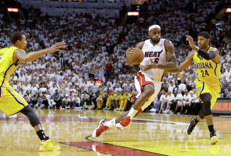 Indiana's Paul George, right, and Miami's LeBron James have faced off twice in the playoffs over the past two years. The Pacers hope to snap the losing streak. Photo: Lynne Sladky, STF / AP