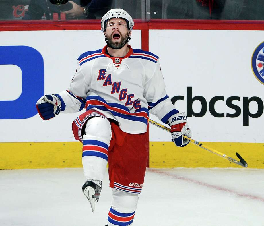Martin St. Louis celebrates after scoring one of the Rangers' seven goals in a 7-2 victory at Montreal in the first game of the NHL Eastern Conference finals. Photo: Ryan Remiorz, SUB / CP