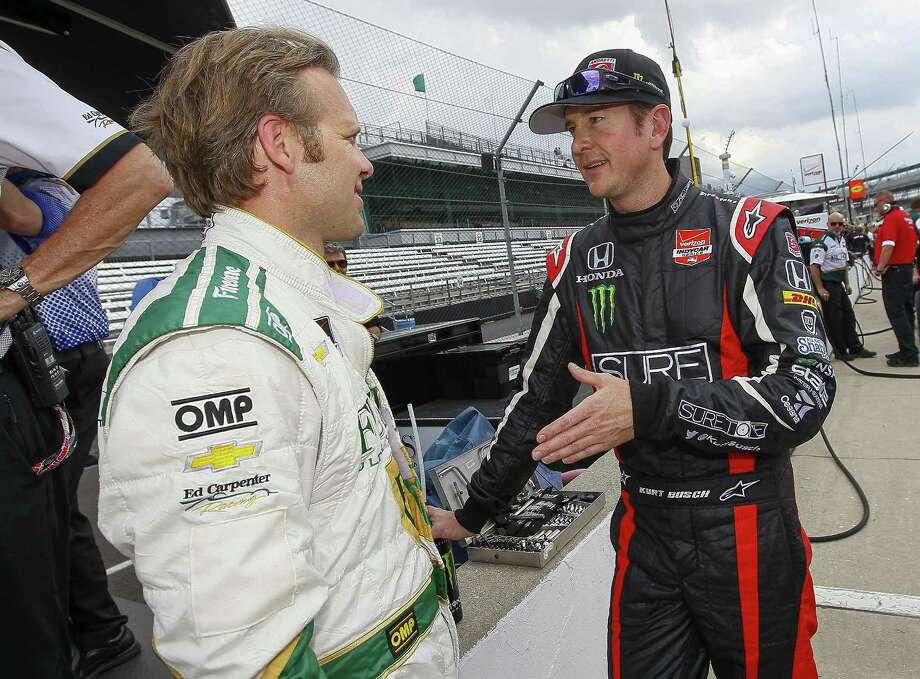 NASCAR Sprint Cup veteran Kurt Busch, right, who qualified in the 10th spot for the Indianapolis 500 on May 25, talks with IndyCar driver Ed Carpenter, who had the fastest qualifying run Saturday heading into today's shootout for the pole position. Photo: Michael Hickey, Stringer / 2014 Getty Images