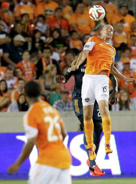 Dynamo forward Mark Sherrod wins the aerial battle against the Galaxy in the second half Saturday as the Orange prevailed 1-0 at BBVA Compass Stadium. Photo: Thomas B. Shea, Freelance / © 2014 Thomas B. Shea