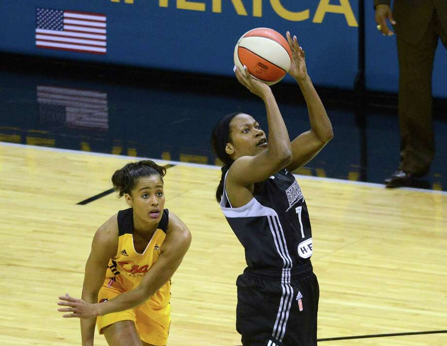 Jia Perkins, led the San Antonio Shock with 20 points, shoots agains the Tulsa Shock during WNBA action in the AT&T Center on Saturday, May 17, 2014. Photo: Billy Calzada, San Antonio Express-News / San Antonio Express-News