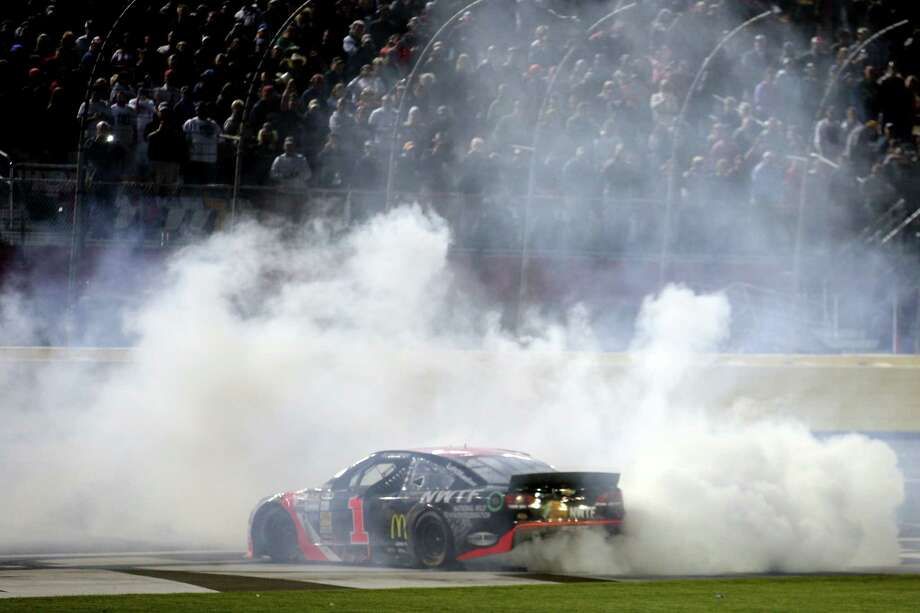 CHARLOTTE, NC - MAY 17: Jamie McMurray, driver of the #1 Bass Pro Chevrolet, celebrates with a burnout after winning the NASCAR Sprint Cup Series Sprint All-Star Race at Charlotte Motor Speedway on May 17, 2014 in Charlotte, North Carolina.  (Photo by Chris Graythen/Getty Images) ORG XMIT: 463762669 Photo: Chris Graythen / 2014 Getty Images