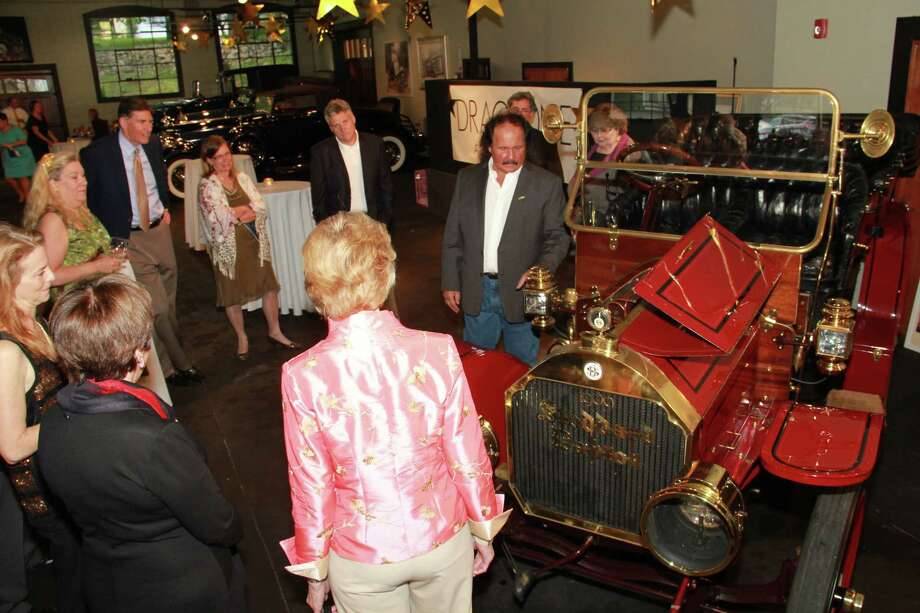 "Attendees got a private tour of the luxury cars at Dragone Classic Motorcars Showroom in Westport during ""The Science of Luxury: From Cars to Stars"" fundraising event for the Discovery Museum in Bridgeport. The event also featured telescope viewings and an astronomy presentation, food and drink , cigars and auctions. Were you SEEN amongst the cars and stars on May 17? Photo: Derek T.Sterling, /Hearst Connecticut Media Group"