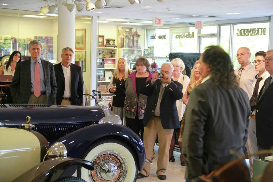 """Attendees got a private tour of the luxury cars at Dragone Classic  Motorcars Showroom in Westport during """"The Science of Luxury: From Cars  to Stars"""" fundraising event for the Discovery Museum in Bridgeport on  May 17, 2014. The event also featured telescope viewings and an  astronomy presentation, food and drink , cigars and auctions.More photos from this event  Photo: Derek T.Sterling, /Hearst Connecticut Media Group"""