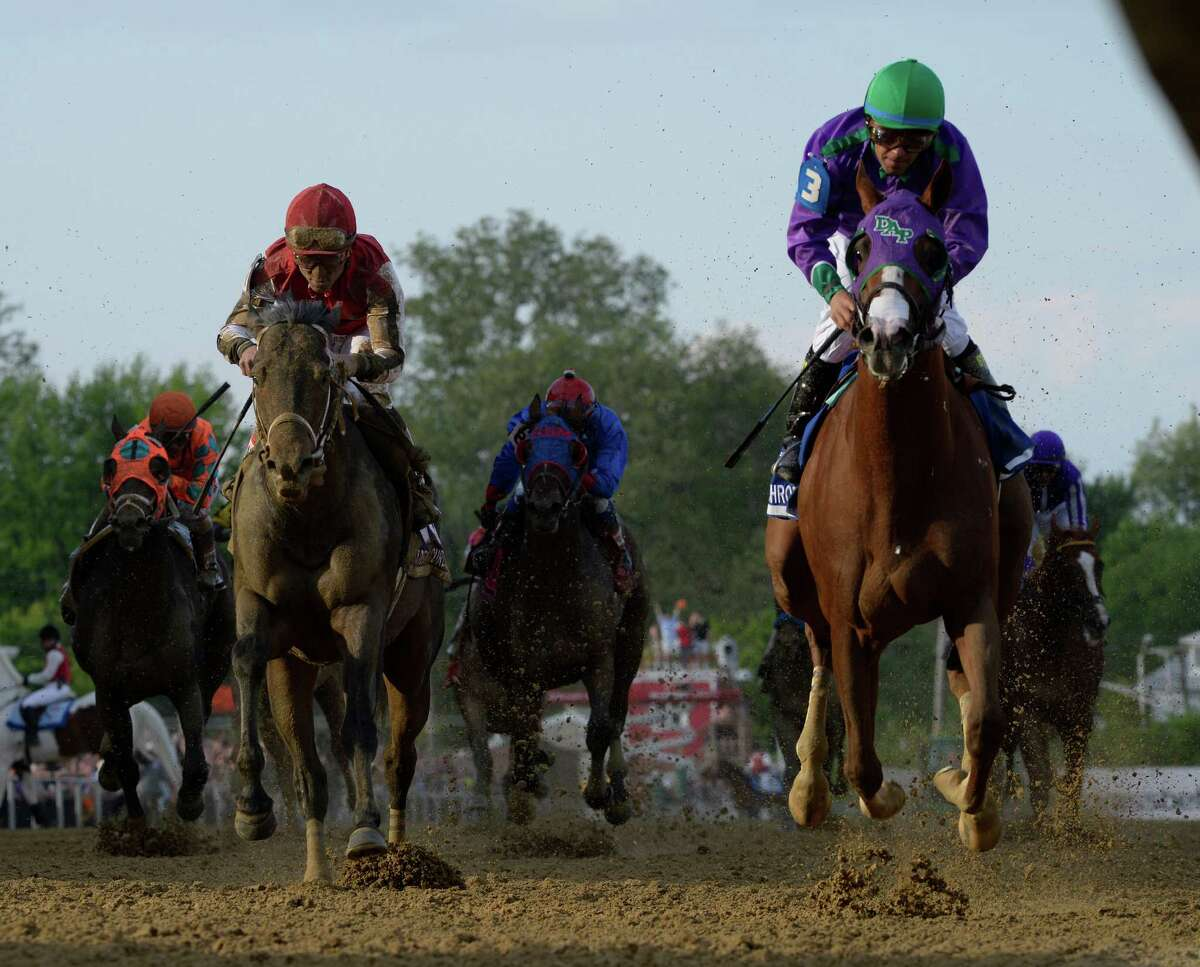 California Chrome, with jockey Victor Espinoza in the irons, wins the second leg of thoroughbred racing's Triple Crown with his victory in the 139th running of the Preakness Stakes on May 17, 2014, at Pimlico Race Course in Baltimore.