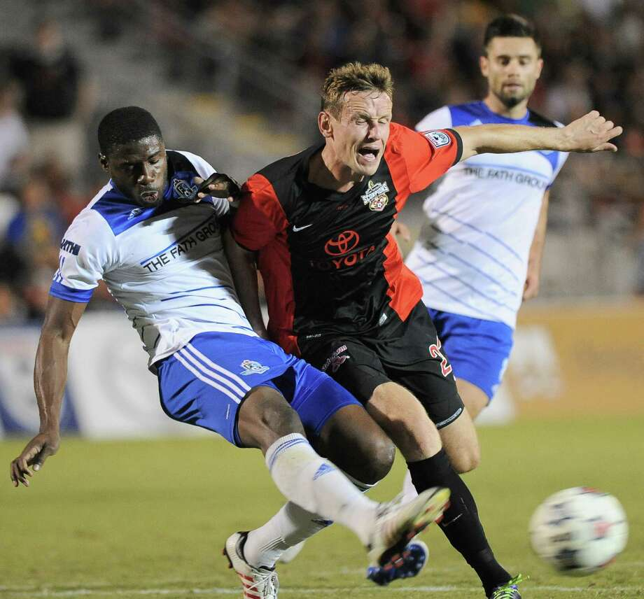 The Scorpions' Tomasz Zahorski (right) battles with Edmonton's Kareem Moses (left) during the second half at Toyota Field. The Scorpions were blanked for the third time in six games. Photo: Photos By Darren Abate / For The Express-News / Darren Abate/DA Media, LLC