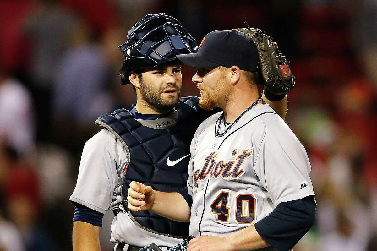 Tigers reliever Phil Coke (right) and catcher Alex Avila celebrate. Detroit is a majors-best 26-12.