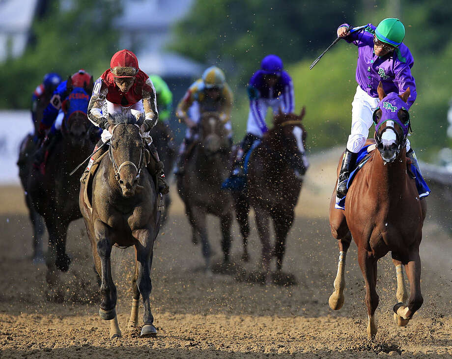 California Chrome (right), with jockey Victor Espinoza, wins the 139th Preakness Stakes in Baltimore by 11/2 lengths over Ride On Curlin in 1:54.84. Photo: Rob Carr / Getty Images / 2014 Getty Images