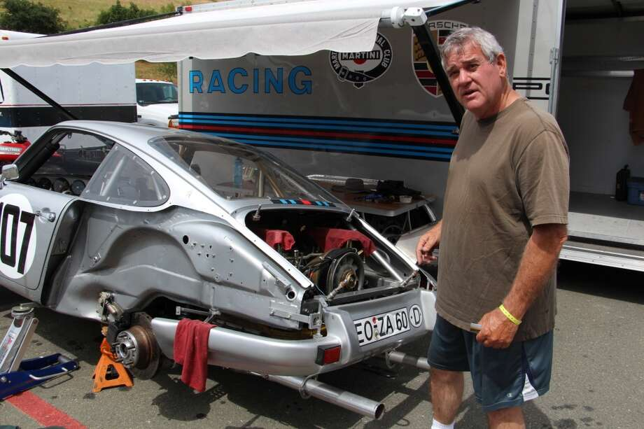 Jim Calzia of Sunnyvale, Calif., working on his 1973 Porsche RSR. He was waiting for a UPS delivery of a part for the mechanical fuel injection pump.  (All photos by Michael Taylor)