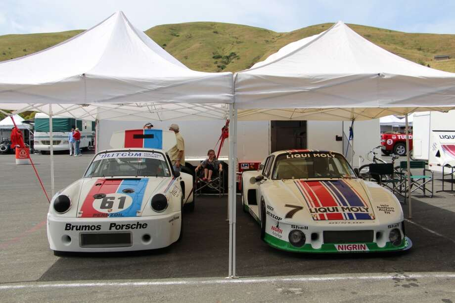 A brace of Porsches: a 1975 911 RSR, left, and a 1979 935. In the chair is Ainsley Harris, 10, daughter of the 1975 car's driver, Brad Harris, of Novato, Calif.