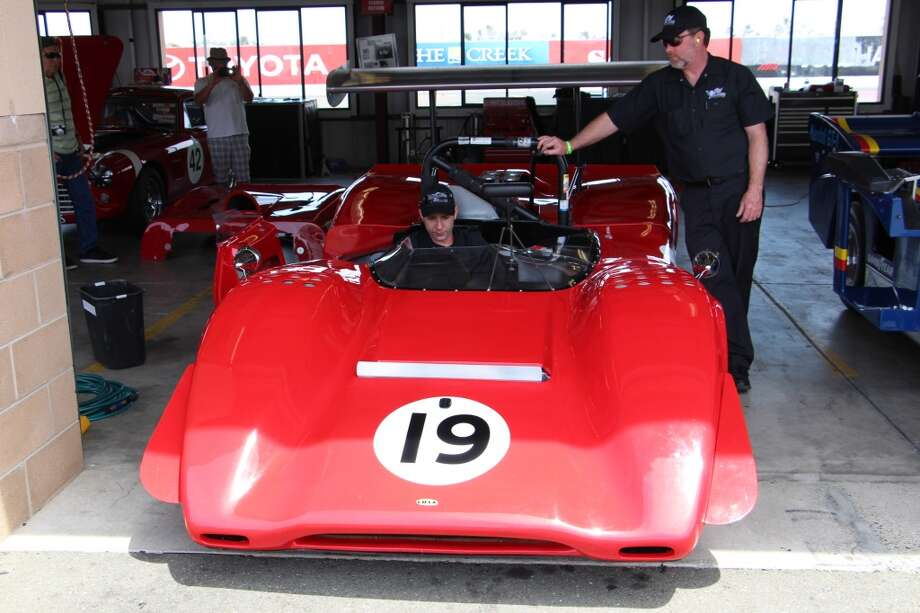 A 1963 Lola T-163, entered by Greg Mitchell of Watsonville, Calif. At right, Kevin Phillips.