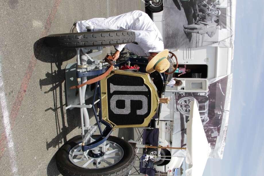 Mechanic Bill Bennett works on a 1912 Packard owned by Brian Blain of Visalia, Calif.