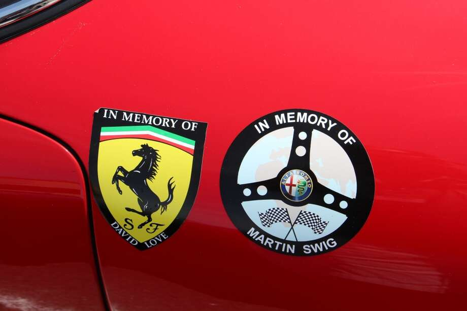 Appliqués  on the side of Tom Price's Ferrari 250GTO memorializes the deaths of two much-loved and well-respected men in the world of car collecting and auto racing -- David Love, Ferrari owner and founding member of the Classic Sports Racing Group, who died Oct. 4, 2013; and Martin Swig, noted Bay Area car collector and founder of the California Mille, an annual 1,000-mile rally around Northern California. Martin Swig died on July 3, 2012.