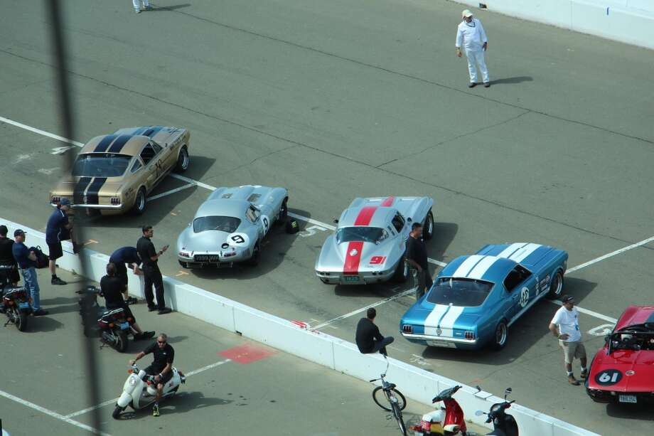 Cars lining up for the start of a race.
