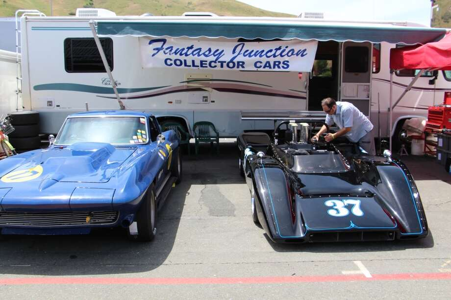 Spencer Trenery of Fantasy Junction, a purveyor of classic sports and racing cars in Emeryville, Calif. Trenery is working on a McLaren M8C. Car on left is a 1964 Corvette.