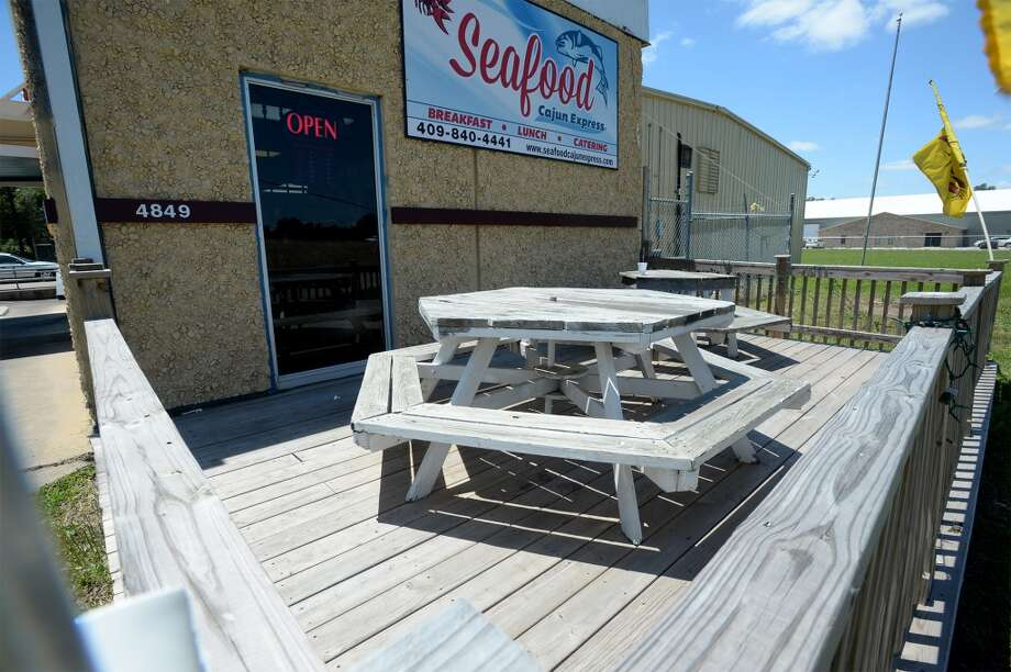 Outdoor seating at Seafood Cajun Express on West Cardinal Drive.   Photo taken Tuesday, May 06, 2014 Guiseppe Barranco/@spotnewsshooter