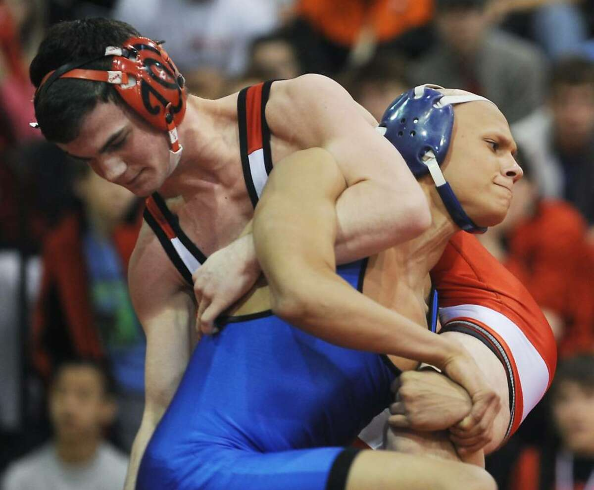 Brandon McBreairty, of Fairfield Warde, wrestles Danny Pack, of Harding, in the 130 lbs class of the FCIAC wrestling championship at New Canaan High School in New Canaan, Conn. on Friday, Feb. 12, 2010. McBreairty won the match.