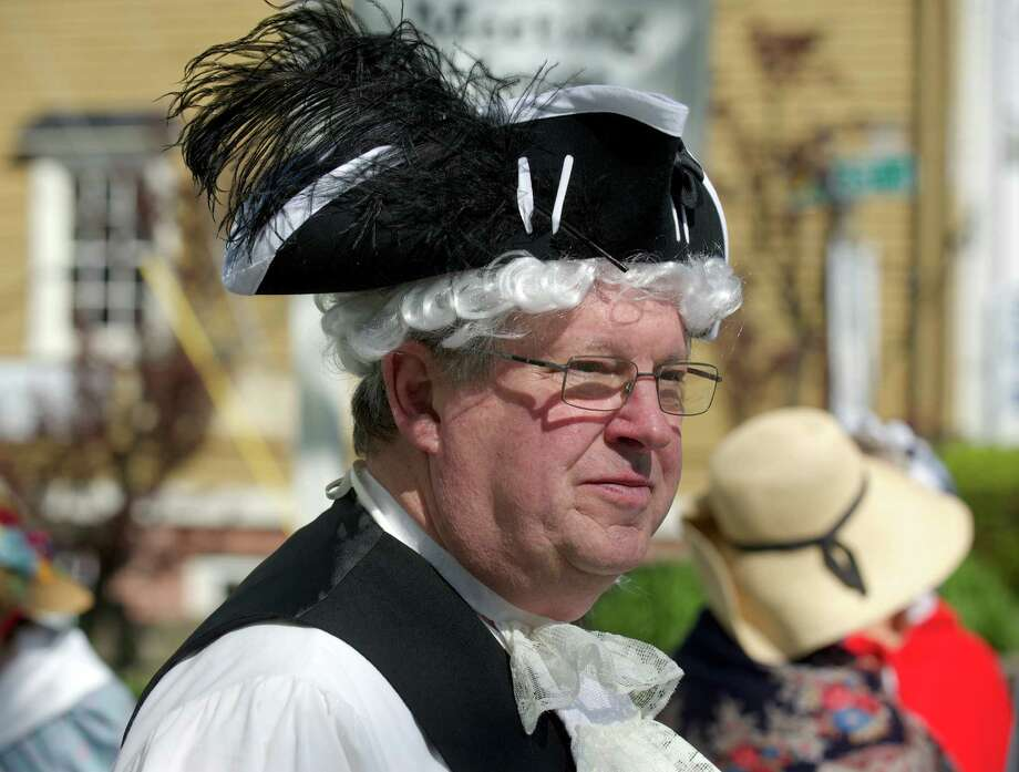 Richard Hubert, 69, of Newtown, stands in front of the Newtown Meeting House to take part in the celebration of the 300th anniversary of the Newtown Congregational Church, on Sunday, morning, May 18, 2014. Members of the church dressed in colonial costumes and walked from their original meeting house, now the Newtown Meeting House, located at the flagpole in Newtown, Conn, to their present sanctuary, on West Street. Photo: H John Voorhees III / The News-Times Freelance