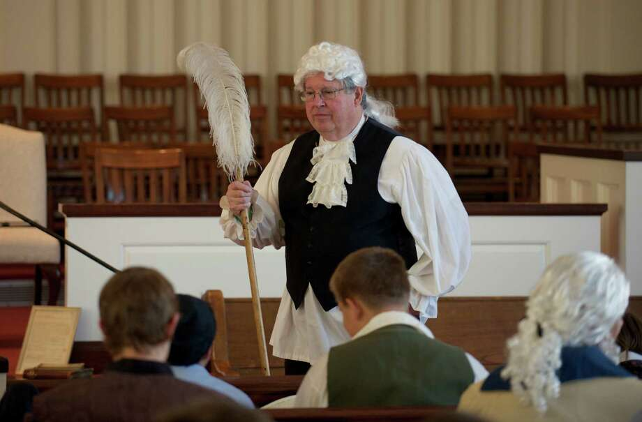 Richard Hubert, 69, of Newtown, stands at the front of the Newtown Congregational Church dressed in colonial costume as part of the 300th anniversary of the church, on Sunday, morning, May 18, 2014. Members of the church dressed in colonial costumes and walked from their original meeting house, now the Newtown Meeting House, located at the flagpole in Newtown, Conn, to their present sanctuary, on West Street. Photo: H John Voorhees III / The News-Times Freelance