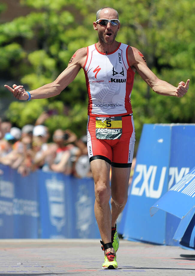 Male pro winner Bevan Docherty makes his way to the finish line during the Ironman Texas triathlon, Saturday, May 17, 2014, in The Woodlands. Photo: Eric Christian Smith, For The Chronicle