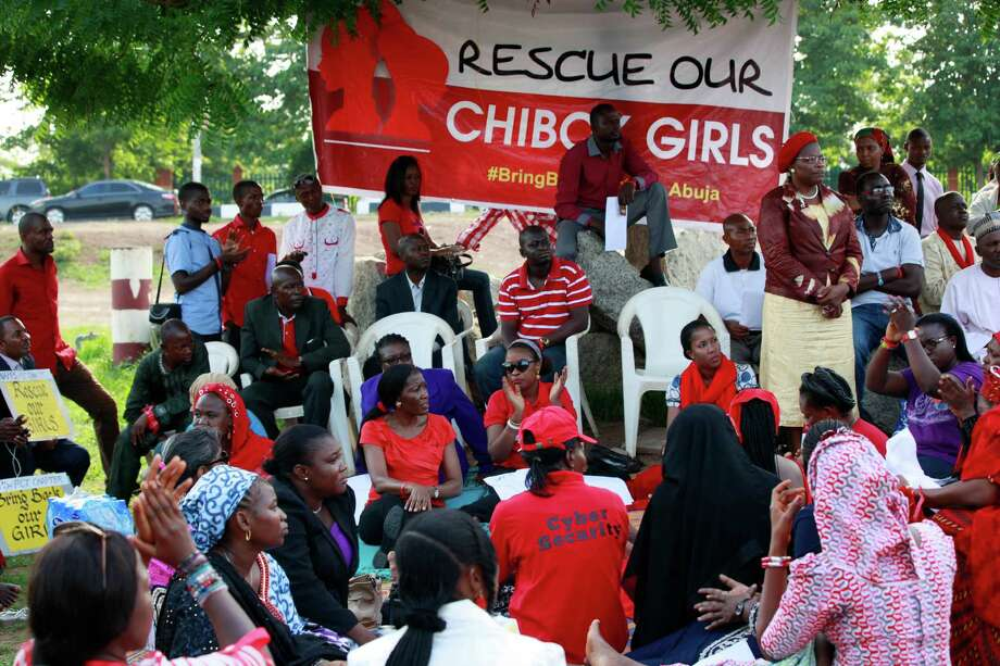 People attend a sit down rally calling on the government to rescue the kidnapped school girls of the Chibok secondary school, in Abuja, Nigeria, Thursday, May 15, 2014.  Islamic militants again attacked the remote Nigerian town from which nearly 300 schoolgirls were kidnapped, Nigeria's military said Wednesday, resulting in a firefight that killed 12 soldiers and led angry troops to fire into the air when their commanding officer came to pay respects to those killed at a barracks in Maiduguri, the state capital. Photo: Sunday Alamba, AP  / AP