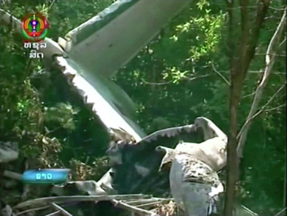 This image taken from video provided by Lao National TV, shows the wreckage of a Lao air force plane which crashed in a forested area of Xiangkhoung province, Laos Saturday, May 17, 2014. The Lao air force plane carrying senior government officials crashed Saturday, killing at least five people on board, including the country's Defense Minister Douangchay Phichit, Thai officials said. (AP Photo/Lao National TV via AP Video)  Photo: Uncredited, AP  / AP2014