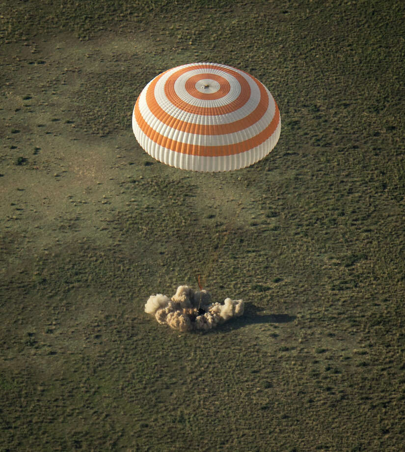 A Russian Soyuz TMA-11M space capsule lands about 150 km (93 miles) southeast of the Kazakh town of Dzhezkazgan, Kazakhstan, Wednesday, May 14, 2014. The Soyuz space capsule carrying three astronauts who had spent a half-year aboard the International Space Station landed Wednesday in the steppes of Kazakhstan. Photo: Bill Ingalls, AP  / (NASA/Bill Ingalls)2014