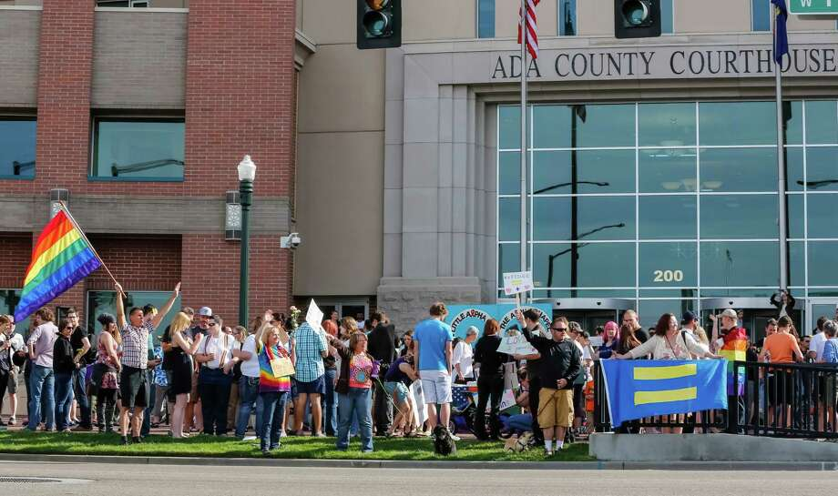 Same sex marriage supporters celebrate in front of the Ada County Courthouse in Boise, Idaho, on Friday, May 16, 2014. Idaho's gay marriage ban was overturned Tuesday when U.S. District Judge Candy Dale said the law unconstitutionally denied gay and lesbian residents their fundamental right to marry.  On May 15, 2014, a three-judge panel of the 9th U.S. Circuit Court of Appeals issued a temporary stay while it considers whether a longer stay is needed. Photo: Otto Kitsinger, AP  / FR171002 AP