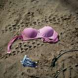 A bra lays on the ground outside a bar after a government crackdown on the illegal mining camp in La Pampa in the Madre de Dios region of Peru, Friday, May 16, 2014. Illegal mining accounts for about 20 percent of Peru's gold exports, and most miners are poor migrants from the Andean highlands. The government started cracking down on illegal gold mining since a nationwide ban took effect April 19.