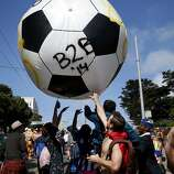 A huge soccer ball entertained the crowd. The annual Bay to Breakers event in San Francisco, Calif.  attracted thousands of runners and revelers as they made their way up the Hayes Street Hill Sunday May 18, 2014.