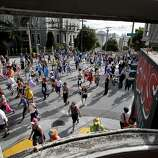 A view of the event from a window at the corner of Fillmore and Hayes Streets. The annual Bay to Breakers event in San Francisco, Calif.  attracted thousands of runners and revelers as they made their way up the Hayes Street Hill Sunday May 18, 2014.